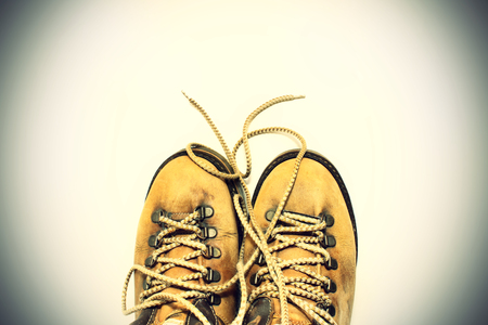 untied: Vintage background yellow shoes with untied shoelaces