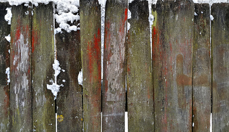 Closeup of old wooden fence in winter photo