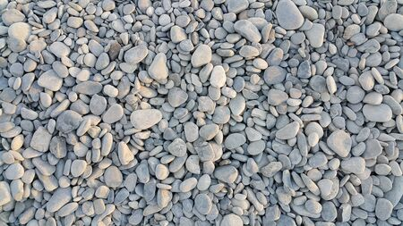 roundish: Nature background from gray sea pebbles Stock Photo