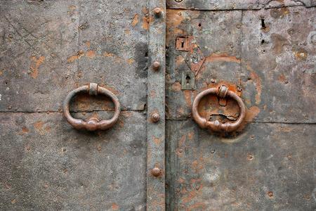 door handle: Old vintage metal door with ring handles and keyholes