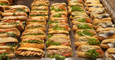 Fresh sandwiches with shrimp, herring, tomato, lettuce salad, pate, cucumber and onion