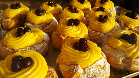 appetizing: Appetizing eclairs with cream and cherry
