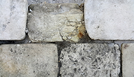 artifact: Close up of old limestone block with artifact