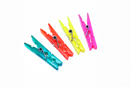 clothespins: Bright colorful clothespins on a white background