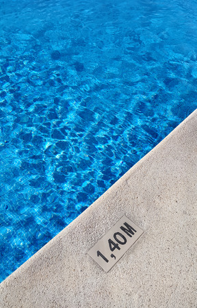 marking: Background of swimming pool with marking depth on concrete border