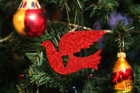Beautiful decorations and red bird close up on faux Christmas tree