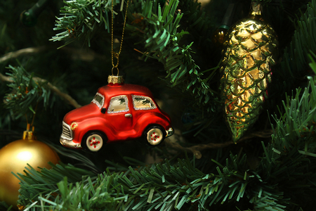 Red car, cone and ball, decorations on faux christmas tree