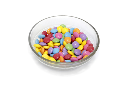 sweetstuff: Bright colorful candy in bowl isolated on white background