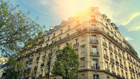 Facade of typical building with attic in Paris, France Stock Photo