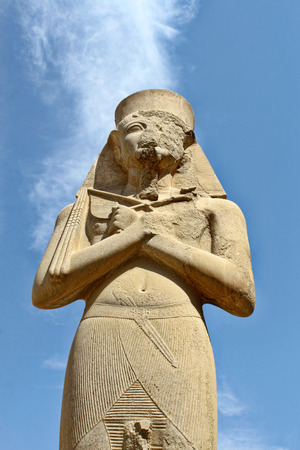 Carved statue of pharaoh Ramses II situated at Karnak Temple complex, Luxsor, Egypt