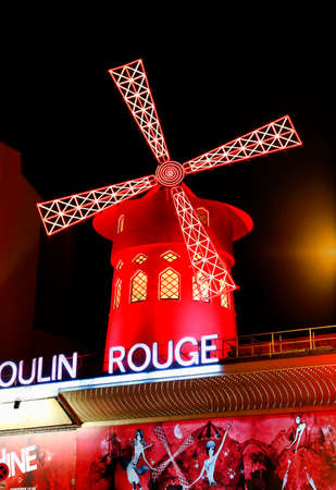 PARIS  FRANCE - 30 APRIL 2017: View of the Moulin Rouge (Red Mill) at night in Paris, a landmark cabaret in the Montmartre neighborhood of the French capital.