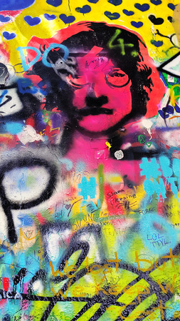 Prague  Czech Republic - June 29, 2018: Detail of the famous John Lennons wall with graffiti in Prague, close-up bright colorful texture