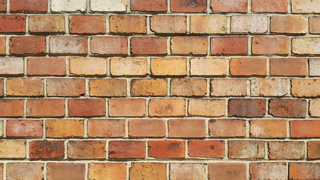 Background of old vintage brick wall texture, close-up