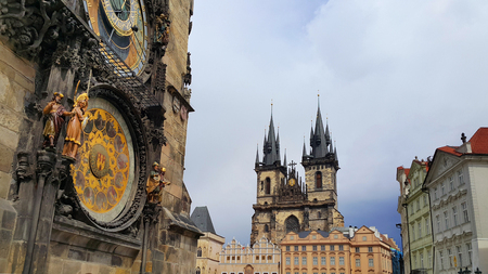 Tyn Cathedral (Church of St. Mother before Tyn) and Old Town Hall Tower (Staromestska Radnice) with Astronomical Clock in Prague, Czech Republic