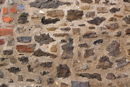 Ancient wall with stones and bricks, close-up texture
