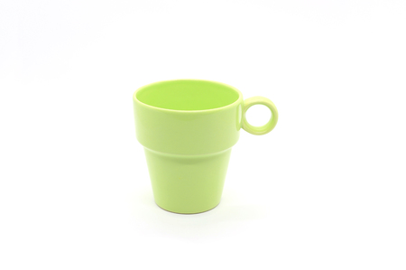 Bright green ceramic cup with handle isolated on white background Фото со стока