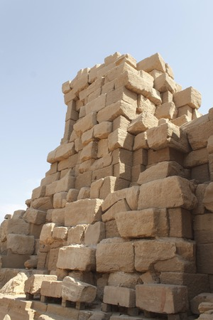 Ancient ruins of Karnak Temple against blue sky in Luxor, Egypt