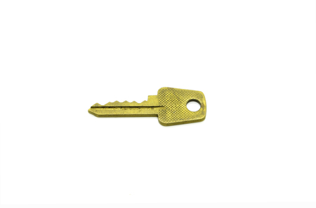 Old metal key to english lock isolated on white background