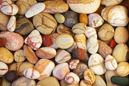 Set of beautiful colorful stones with different pattern polished by the sea, natural close-up background