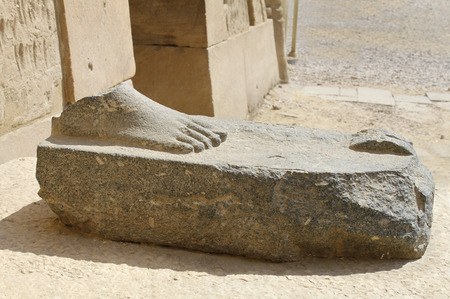 Feet of ancient ruined statue in Karnak Temple, Luxor, Egypt