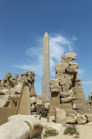 Ancient ruins and obelisk of Karnak Temple in Luxor, Egypt