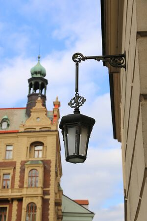 Traditional vintage street lamp and architecture of beautiful Prague, Czech Republic