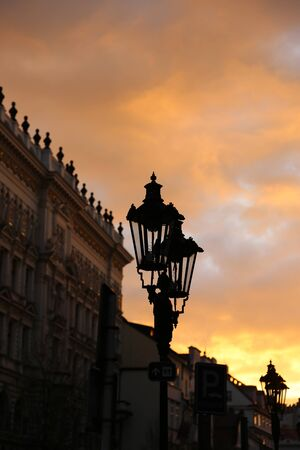 Traditional vintage street lamp and architecture of Prague in the evening Stock Photo