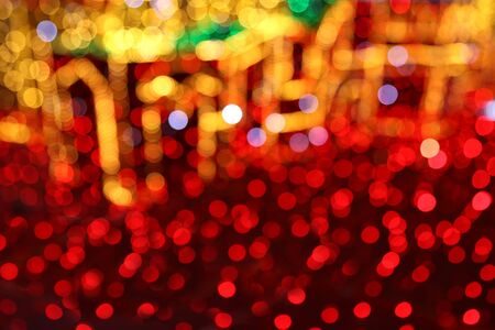 Bright Christmas decoration, colorful lights of bulbs, abstract background out of focus