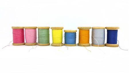 Spools of bright multi-colored threads isolated on a white background