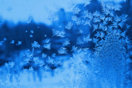Beautiful ice patterns on winter window, natural close-up background or texture