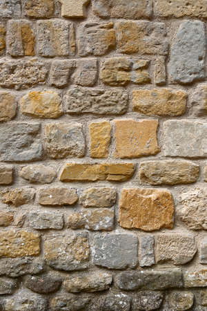 Very ancient stone wall, architectural background, closeup texture