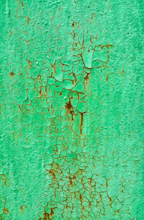 Texture of green painted metallic wall cracked and rusty from time, vintage weathered background Standard-Bild