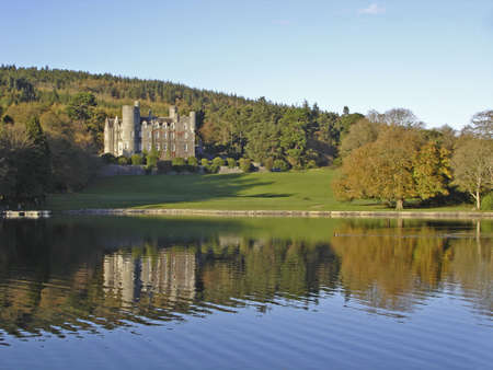 Castlewellan castle, Ireland, reflecting onto the lake in the evening sun