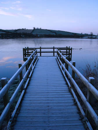 A pier on a freezing pre dawn morning in winter. Stock Photo