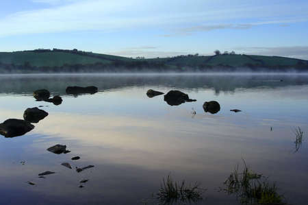 Dawn On A Misty Lake                               Stock Photo