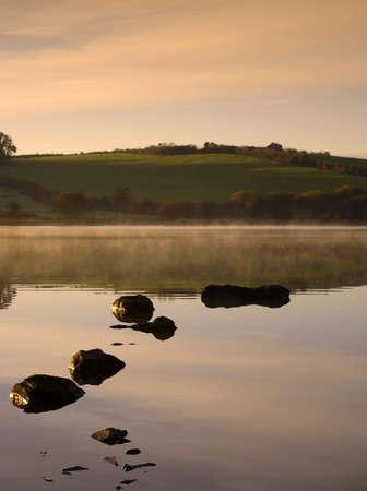 Dawn on a Misty Irish Lake Stock Photo