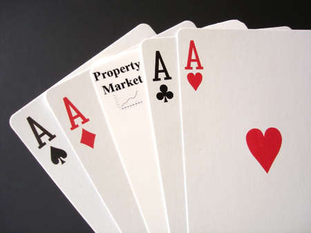 Poker Aces and a Property Market card for a gamble.