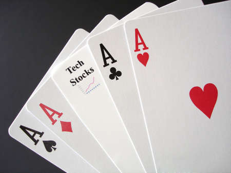 Poker Aces and a Tech Stock card, white on black                                  Stock Photo
