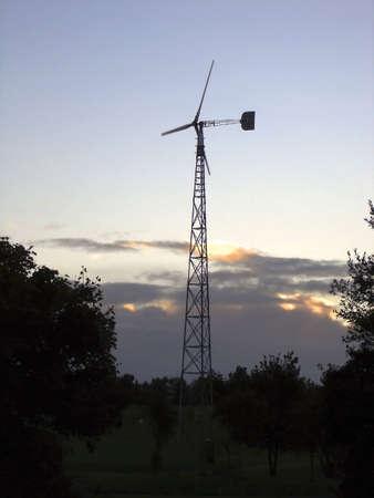 Wind Turbine Against A Setting Sun Stock Photo