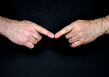 Touching fingertips symbol of teamwork                            Stock Photo