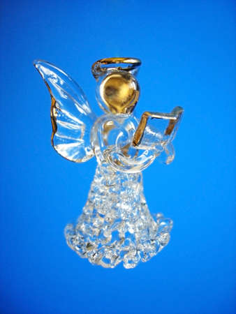 Christmas Angel Decoration on a Blue Background