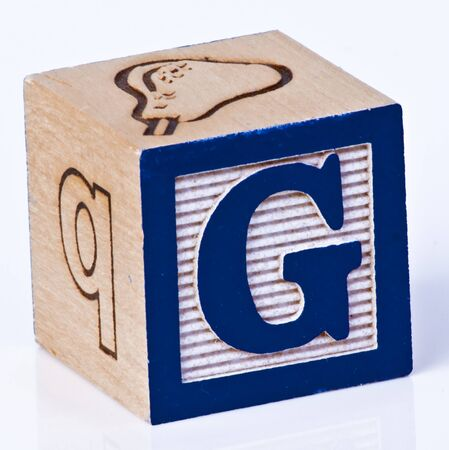 painted wood: Wooden Block Letter G Stock Photo