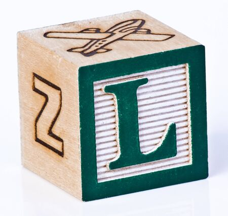carved letters: Wooden Block Letter L Stock Photo