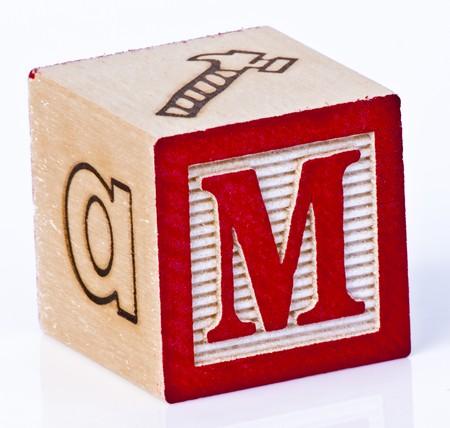 carved letters: Wooden Block Letter M