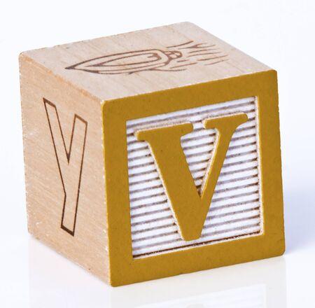 carved letters: Wooden Block Letter V