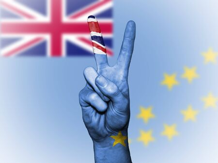 Hand showing the international symbol for peace, decorated in the national colors of Tuvalu