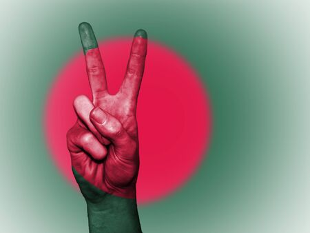 Hand showing the international symbol for peace, decorated in the national colors of Bangladesh