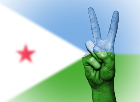 djibouti: Hand showing the international symbol for peace, decorated in the national colors of Djibouti