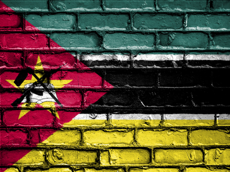 royalty free photo: National Flag of Mozambique on a Brick Wall