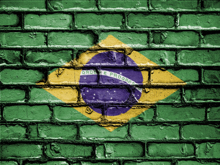 royalty free photo: National Flag of Brazil on a Brick Wall